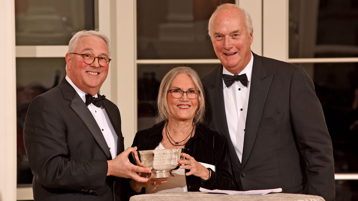 Chancellor Woodson, Adelaide Gomer, and Charlie Stallings with the Menscer Cup