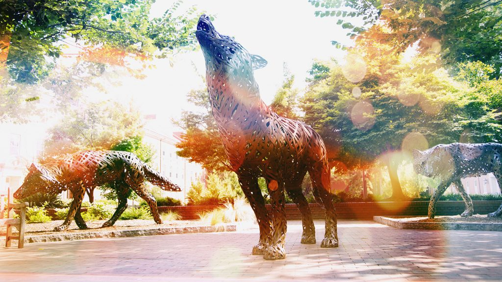 three wolf statues howling with bright filter